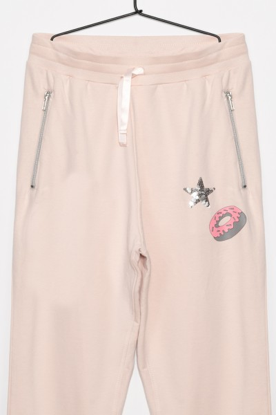 Dziewczęce spodnie dresowe z ozdobnymi naszykwami